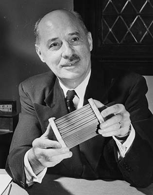 Eugene Houdry, a French mechanical engineer, with the catalytic converter he invented.
