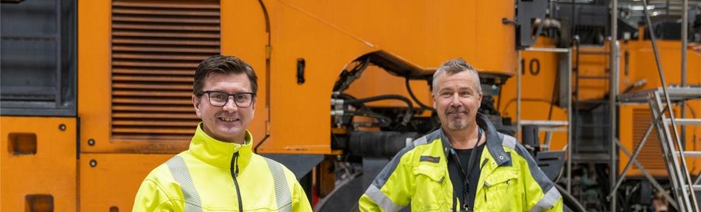 Två män från Sandvik i arbetskläder