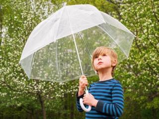 A boy with an umbrella made of plastics
